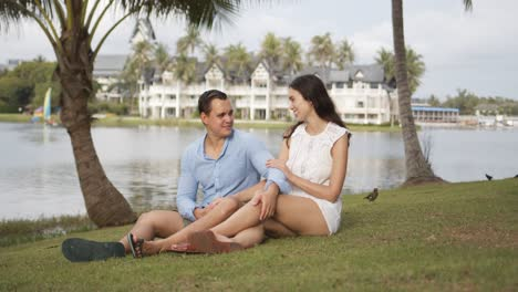 Joyful-couple-tourists-spending-time-on-lawn