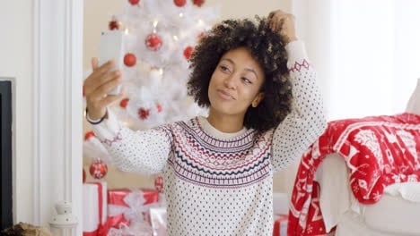 Young-woman-posing-for-a-Christmas-selfie