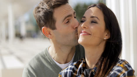 Amorous-young-man-kissing-his-girlfriend