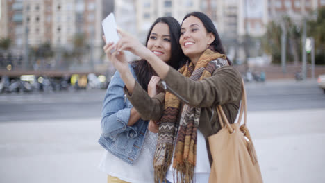 Two-gorgeous-women-posing-for-a-selfie