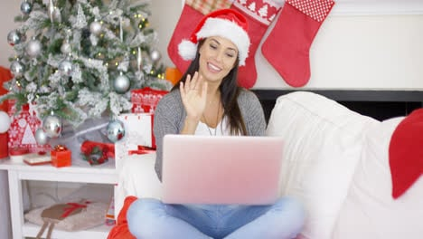 Happy-woman-making-a-Christmas-video-chat