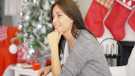 Cheerful-woman-in-a-festive-Christmas-home