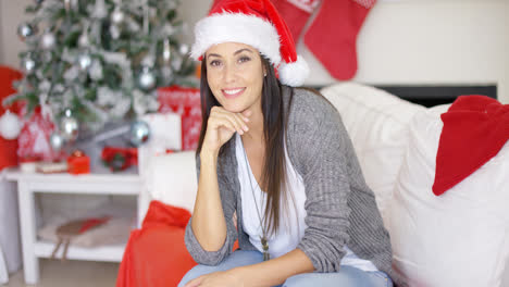 Smiling-pretty-woman-celebrating-Christmas-at-home