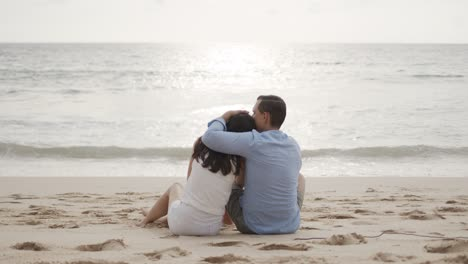 Young-lovers-on-honeymoon-hugging-at-beautiful-sea-beach