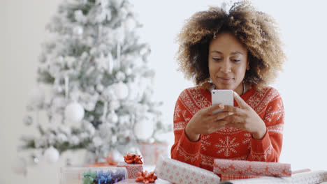Young-woman-checking-for-Xmas-messages