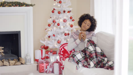 Woman-relaxing-during-the-Christmas-holiday-season