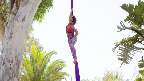 Exotic-acrobatic-dancer-working-out-on-silk-ribbon