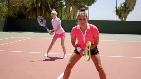 Two-young-women-playing-tennis-doubles