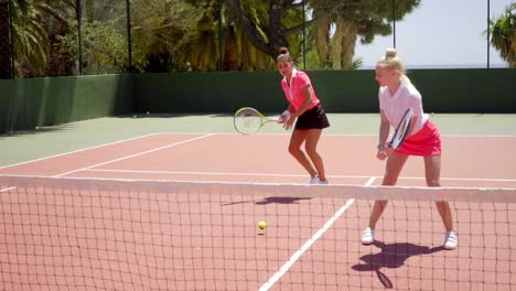 Two-pretty-women-playing-a-game-of-tennis-doubles