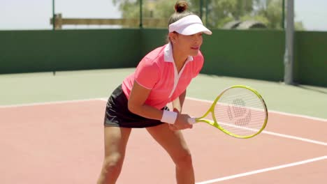 Athletic-shapely-woman-playing-a-game-of-tennis
