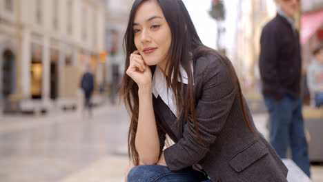Young-woman-sitting-waiting-for-someone