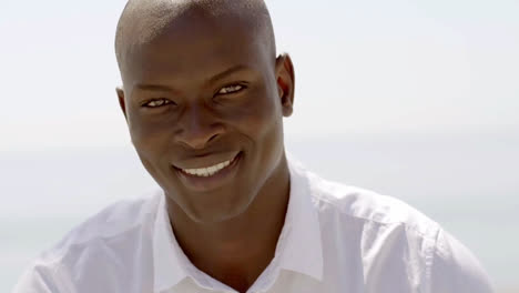Close-up-of-smiling-black-male-model-in-white