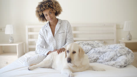 Woman-And-Her-Dog-Resting-In-Bed