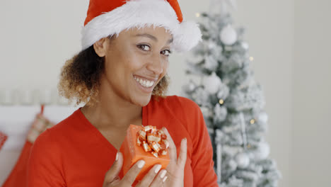 Smiling-attractive-woman-holding-a-Christmas-gift