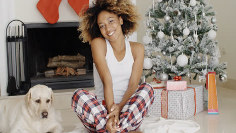 Cute-young-woman-and-her-dog-at-Christmas
