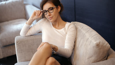 Business-Woman-Relaxing-on-the-Armchair