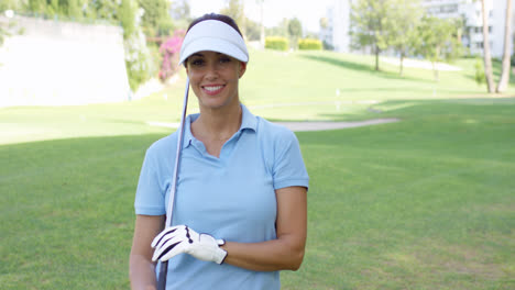 Female-golfer-wearing-visor-and-blue-polo-shirt