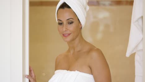Woman-wrapped-in-towel-leaving-shower-stall