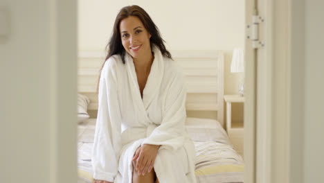 Happy-friendly-young-woman-in-a-white-bath-robe