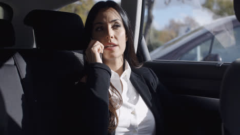 Interior-view-of-woman-on-phone-in-limousine