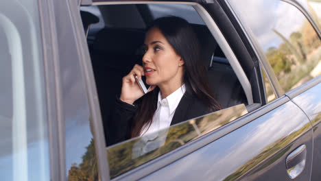 Beautiful-business-woman-on-phone-in-automobile