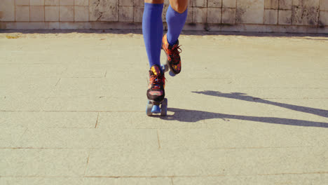Close-Up-on-Girls-Feet-While-Riding-Roller-Skates