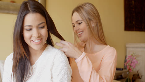 Pretty-Woman-Fixing-the-Hair-of-her-Friend