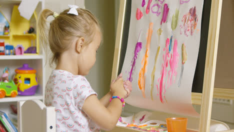 Creative-little-girl-painting-an-abstract-picture