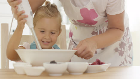 Cute-happy-little-girl-helping-with-the-baking