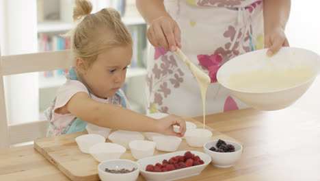 Little-girl-assisting-Mum-with-the-baking
