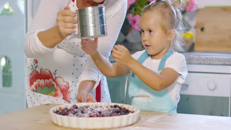 Adorable-little-girl-engrossed-in-baking-a-pie