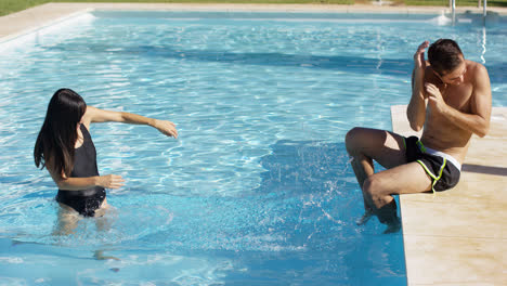 Girlfriend-splashing-her-boyfriend-at-pool