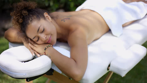 Grinning-woman-resting-on-massage-table