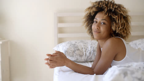Woman-Lying-At-The-End-Of-The-Bed