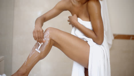 Young-Woman-Is-Shaving-Her-Leg