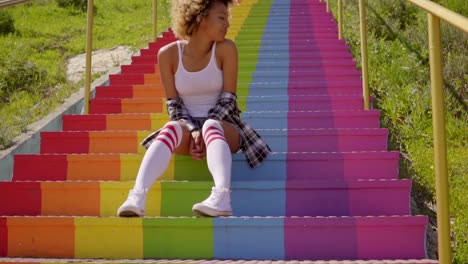 Young-Woman-Sitting-On-The-Colorful-Stairs-