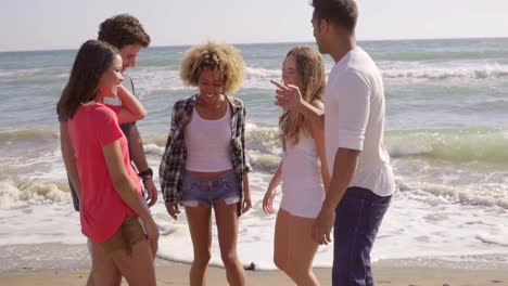 Young-People-Standing-On-The-Beach-