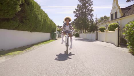 Girl-Riding-With-Feet-Out-On-A-Bicycle