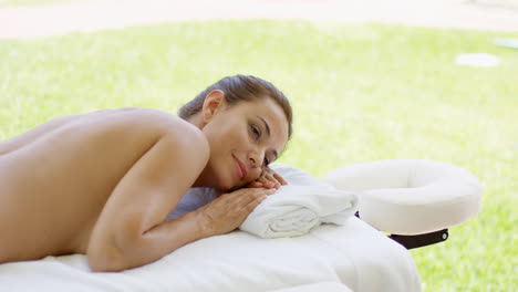 Adorable-middle-aged-woman-laying-on-massage-bed