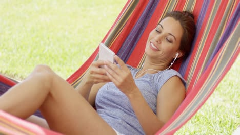 Pretty-young-woman-relaxing-in-a-hammock
