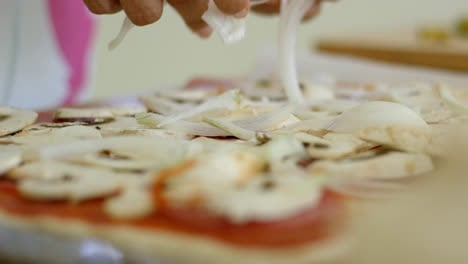 Close-up-of-hands-preparing-food-on-table