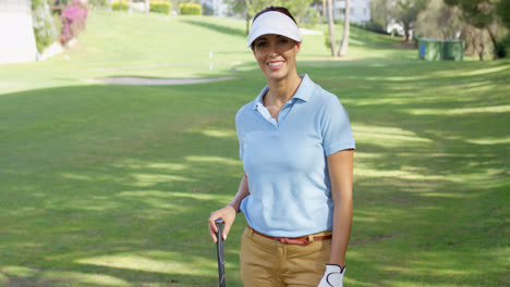 Young-woman-golfer-strolling-across-the-course