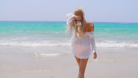 Rear-View-of-Young-Blond-Girl-on-the-Beach