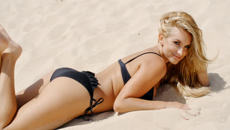 Sensual-Blond-Woman-Lying-on-the-Beach