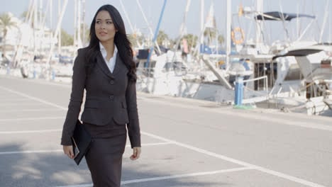 Business-Woman-Walking-On-The-The-Pier