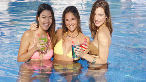 Three-happy-sexy-female-friends-in-a-pool