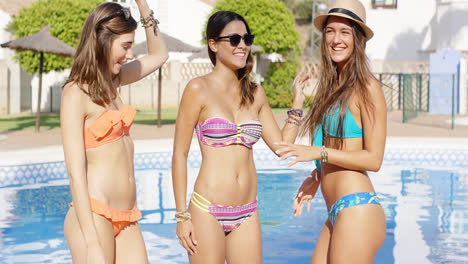 Three-cute-laughing-women-in-bikinis