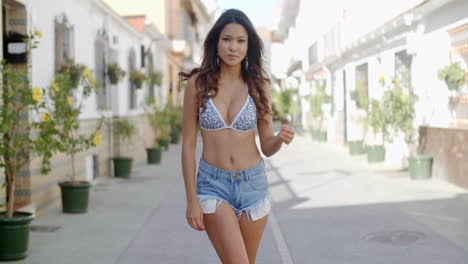 Attractive-young-woman-walking-in-an-urban-lane