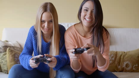 Excited-girls-playing-video-games-at-home