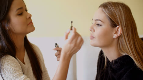 Kind-Friend-Helping-a-Woman-in-Putting-Make-up